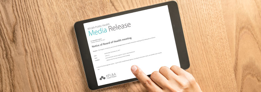 tablet with a KFL&A Public Health media release on the screen