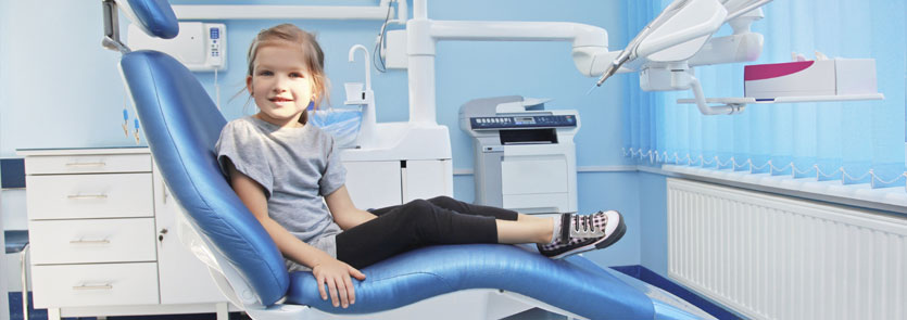 A child in the chair at a dentist's office