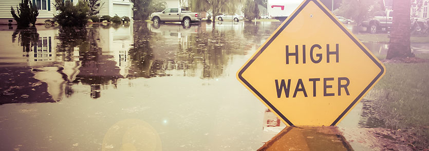 A High Water sign on a flooded street