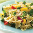 Pasta on plate with fresh veggies.