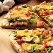 Flat crust pizza with fresh veggies.
