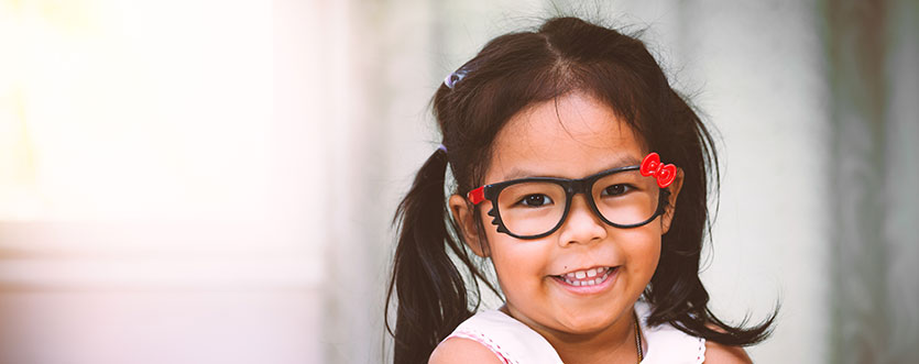 Child wearing glasses.