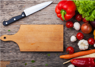 Cutting board, knife, and vegetables.